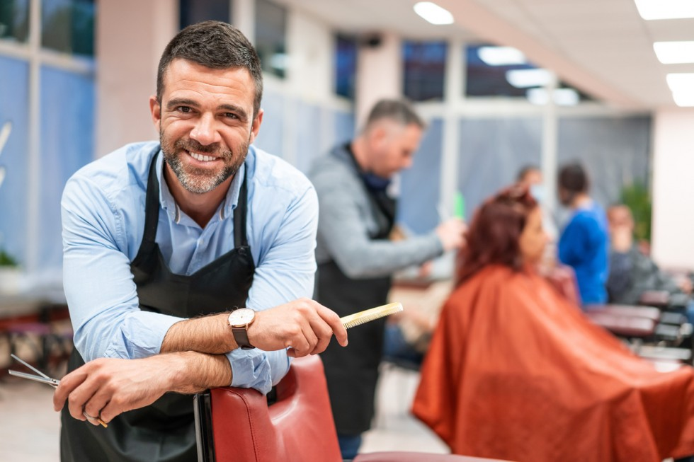 Hairdresser stands in a hairdressing studio