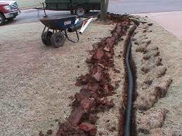 FRENCH DRAINS/RETAINING WALLS