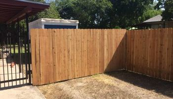 Custom Cedar Privacy Fences and Wrought Iron Fencing