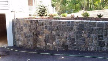 Custom Landscape And Construction, LLC. Unilock walls and patios