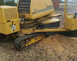 Stump grinding. Grinder has tracks!