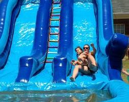 Book your inflatable bounce, slide or waterslide with us!!!!