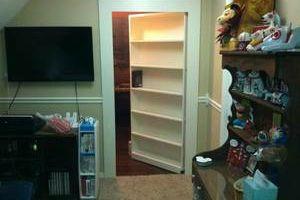 Hidden bookcase door by Murphy Construction