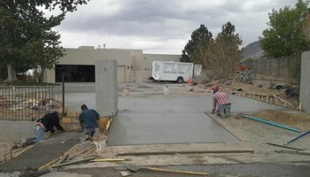 Fernandez Construction. Concrete driveway and yard landscaping