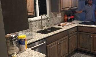 Junior custom construction. Kitchen cabinets & granite