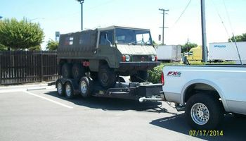 Auto trailering/ towing/ transport service