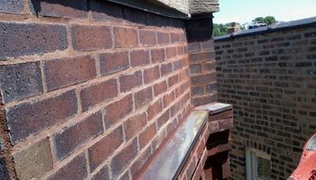MHT Masonry Restoration &Tuckpointing. Chimney Repair
