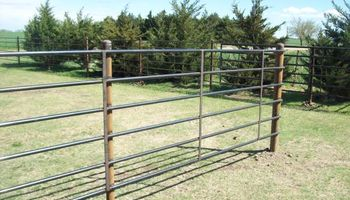 Champlin fence. SUPER SPECIAL on Continuous Pipe Fence INSTALLED