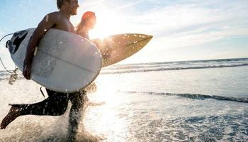 Surfing Lessons & SUP or Stand Up Paddleboard Rentals