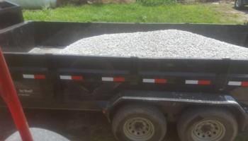 Gravel hauling with Gooseneck dump traile