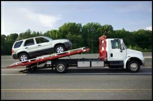 Photo #1: Flatbed Tow Truck Service To And From Manhattan 24 hrs 7 days a week