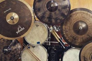 Photo #1: 23 year old professional drummer willing to teach you how to play!