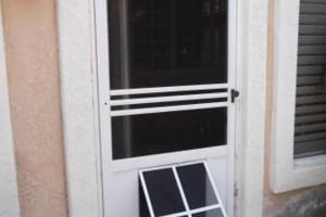 Photo #1: Custom Pet Doors installed into your Screen Door/Patio Slider