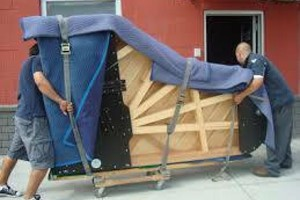 Photo #1: Need Piano Movers? Low Rates - All Major Credit Cards Accepted