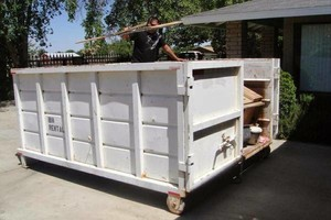 Photo #1: JUNK-B-GONE (Clean-up, Demolition,Hauling& DUMPSTER RENTALS)