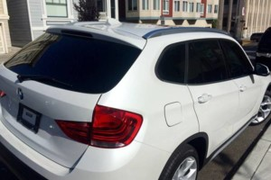 Photo #1: Car Windows Tint - Back $150 & Full $200 - Professional Tinting Shop
