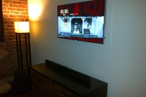 Photo #1: PROFESSIONAL & QUALITY Home Theater & Flat Panel TV Mounting