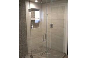 Photo #1: Artisan Glass and Mirror Corp. Heavy Glass Frameless Shower Doors