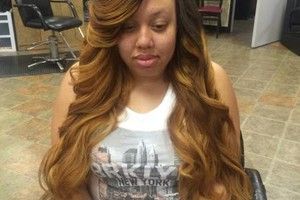Photo #1: $100 sew in special