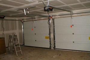Photo #2: Broken Garage Door? Fix it today!