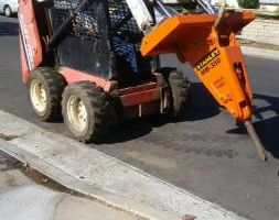 Photo #1: Bobcat Work/ Concrete and Asphalt Demo/ Hauling
