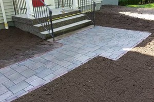 Photo #14: Custom Landscape And Construction, LLC. Unilock walls and patios