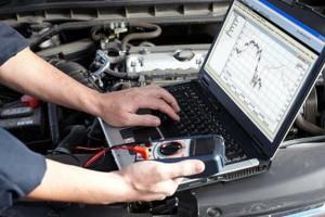 Photo #1: Fix your car! Oil change, rebuild transmission, catalyst...