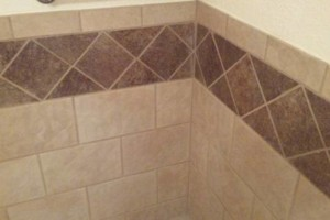 Photo #1: Toro & Son Co. - we sell & install tile