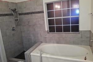 Photo #1: CUSTOM SHOWERS, TILE INSTALLATION FOR LESS THAN $2000