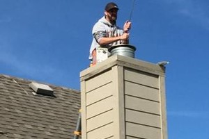 Photo #1: Clint 's Chimney Cleaning