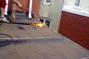 Photo #1: New flat roof 12 year warranty or repair