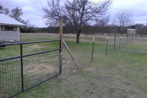 Photo #7: Does your fence need some repairs? Give us a call!