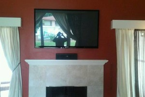 Photo #4: Over Fire Place Tv Mounting - Home Theater