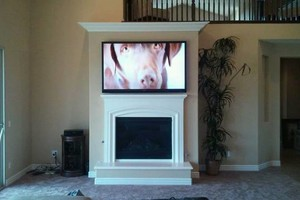 Photo #3: Over Fire Place Tv Mounting - Home Theater