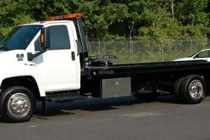 Photo #1: Towing services. One flat price!