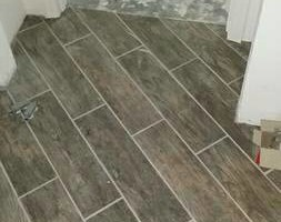Photo #1: Flooring Pros LLC. $1 sqft laminate installation special!
