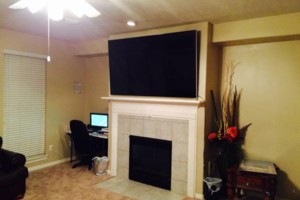 Photo #1: TITAN SOLUTIONS. $65 Quality Tv Mounting/ Wire Concealment!