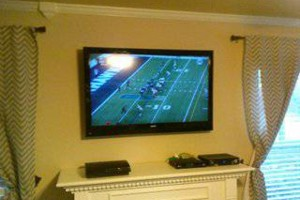 Photo #2: TV Mounting, Media Rooms, Home Theater - same day install!