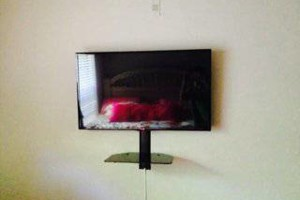 Photo #1: TV Mounting, Media Rooms, Home Theater - same day install!