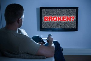 Photo #1: Is Your TV Sick? Call Dr. Mackie! 50% Off Estimate!