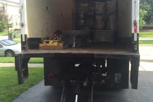 Photo #3: We are the answer on moving day...WE BRING THE MOVING TRUCK +