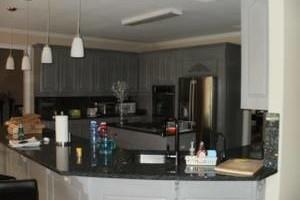 Photo #1: Ugly Cabinets? Cabinet Refinishing :)