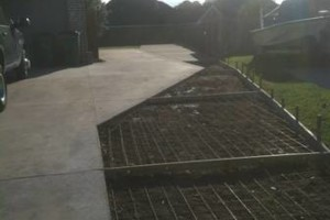 Photo #8: Concrete work (get rid of the mud)
