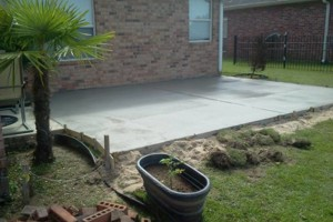 Photo #4: Concrete work (get rid of the mud)