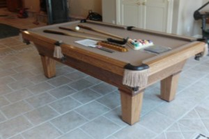 Photo #1: Pool Table Moving by BIG RED BILLIARDS