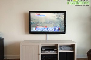Photo #1: TV MOUNTING - Cheaper than GeekSquad and Lifetime. No Fall Guarantee!