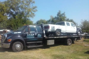 Photo #1: ASAP TOWING (fast, friendly and affordable)