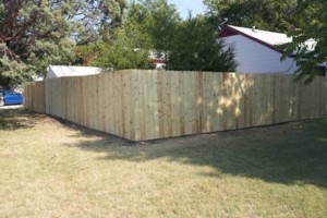 Photo #1: Chain link /Wooden fence