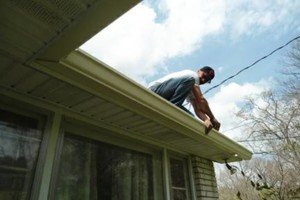 Photo #1: EAGLE SEAMLESS GUTTERS PLUS. Gutter Cleaning