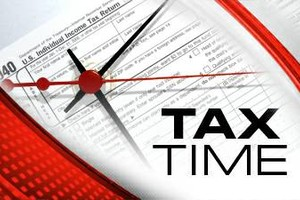 Photo #1: Taxes Done For Less.... By Phone/In Person